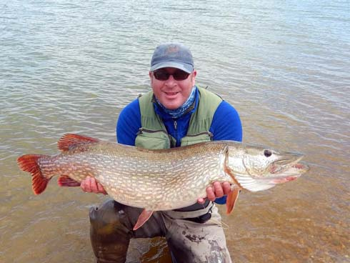 Philip Jordan 27lb Pike from Pistford Water on the fly.jpg