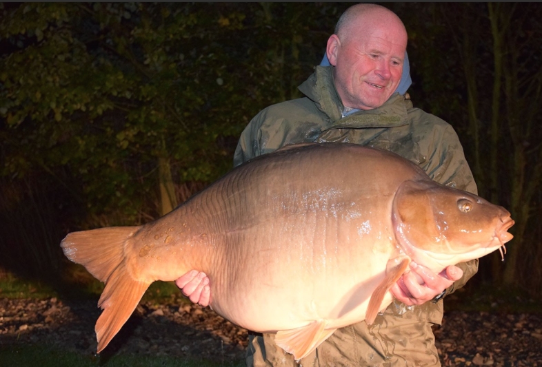 Robby Harrison with Big Rig the carp at a potential British Record weight of 71lb 4oz.