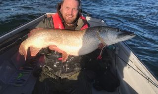 Ben Booth with his 39lb pike from Grafham Water